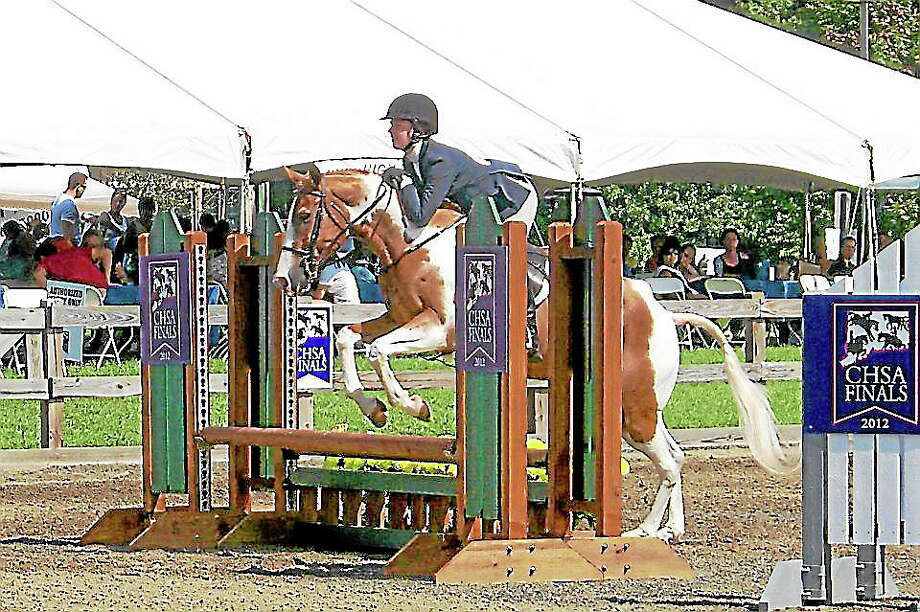 """Morgan O'Sullivan competing in hunter/jumpers. Her study, """"Can't Stride with a 45"""" helped her knowledge of stride length as it pertains to jumping and won her a place in a national agriculture competition. Photo: Submitted Photo"""