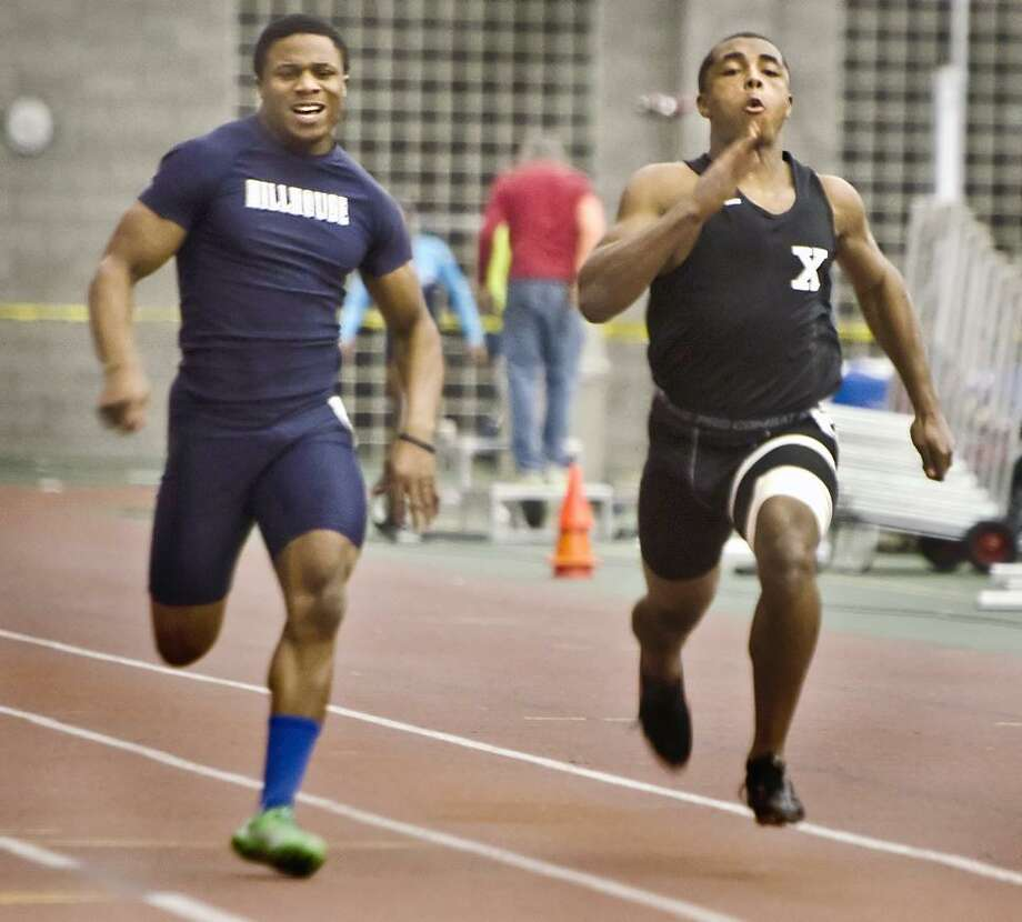 SPORTS-SCC Track Championships.Harold Cooper (L) of Hillhouse, and DeAngelo Berry of Xavier.  Melanie Stengel/Register