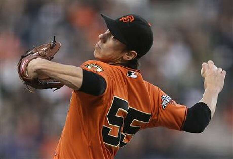 FILE - In this May 24, 2013, file photo, San Francisco Giants' Tim Lincecum works against the Colorado Rockies in the first inning of a baseball game in San Francisco. Lincecum is staying put with the Giants just as he hoped, reaching agreement Tuesday, OCt. 22, 2013, on a $35 million, two-year contract through the 2015 season. The deal is pending a physical, which hadn't been set. (AP Photo/Ben Margot, File) Photo: AP / AP