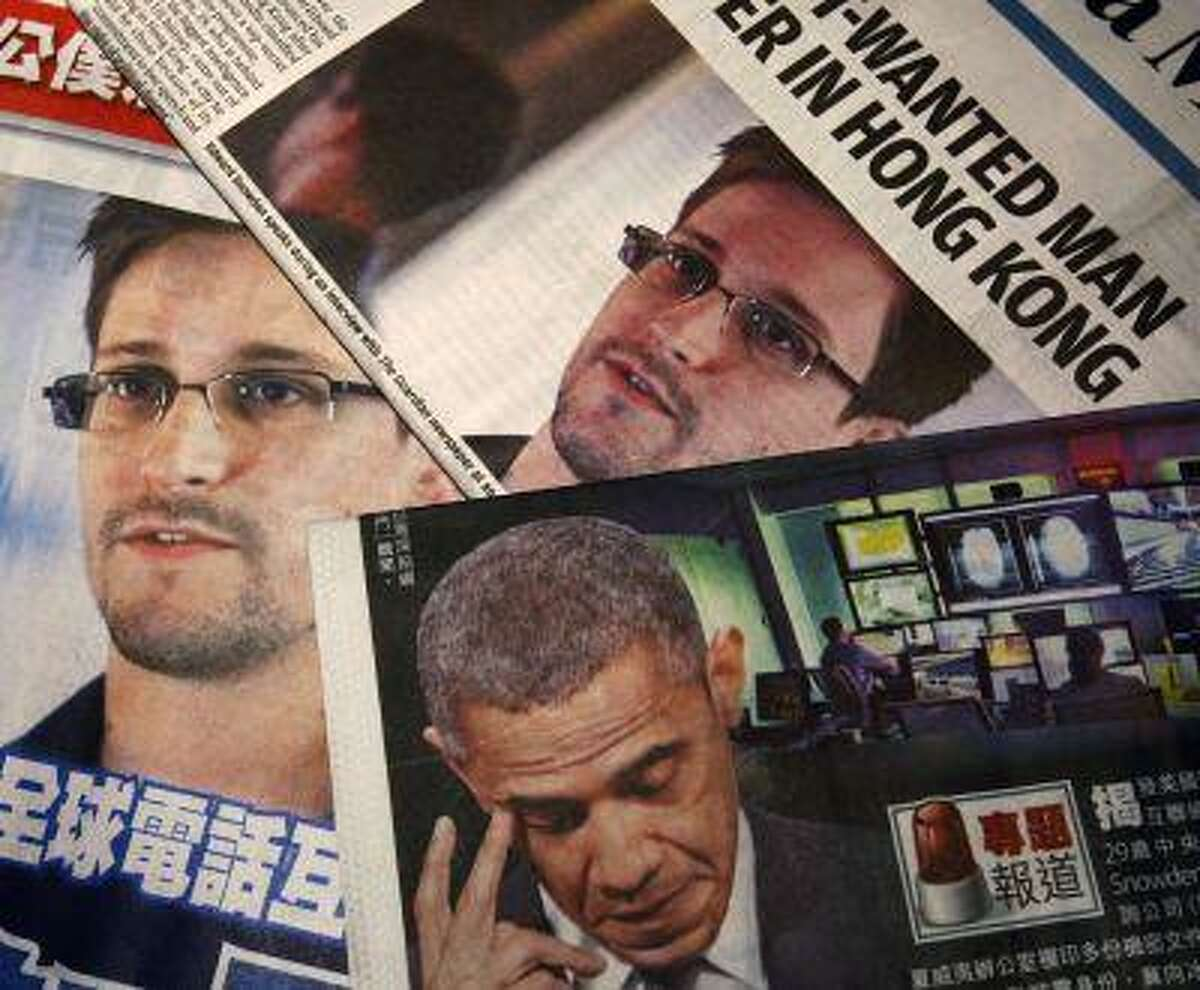 Photos of Edward Snowden, a contractor at the National Security Agency, and U.S. President Barack Obama are printed on the front pages of local English and Chinese newspapers in Hong Kong in this illustration photo June 11, 2013.