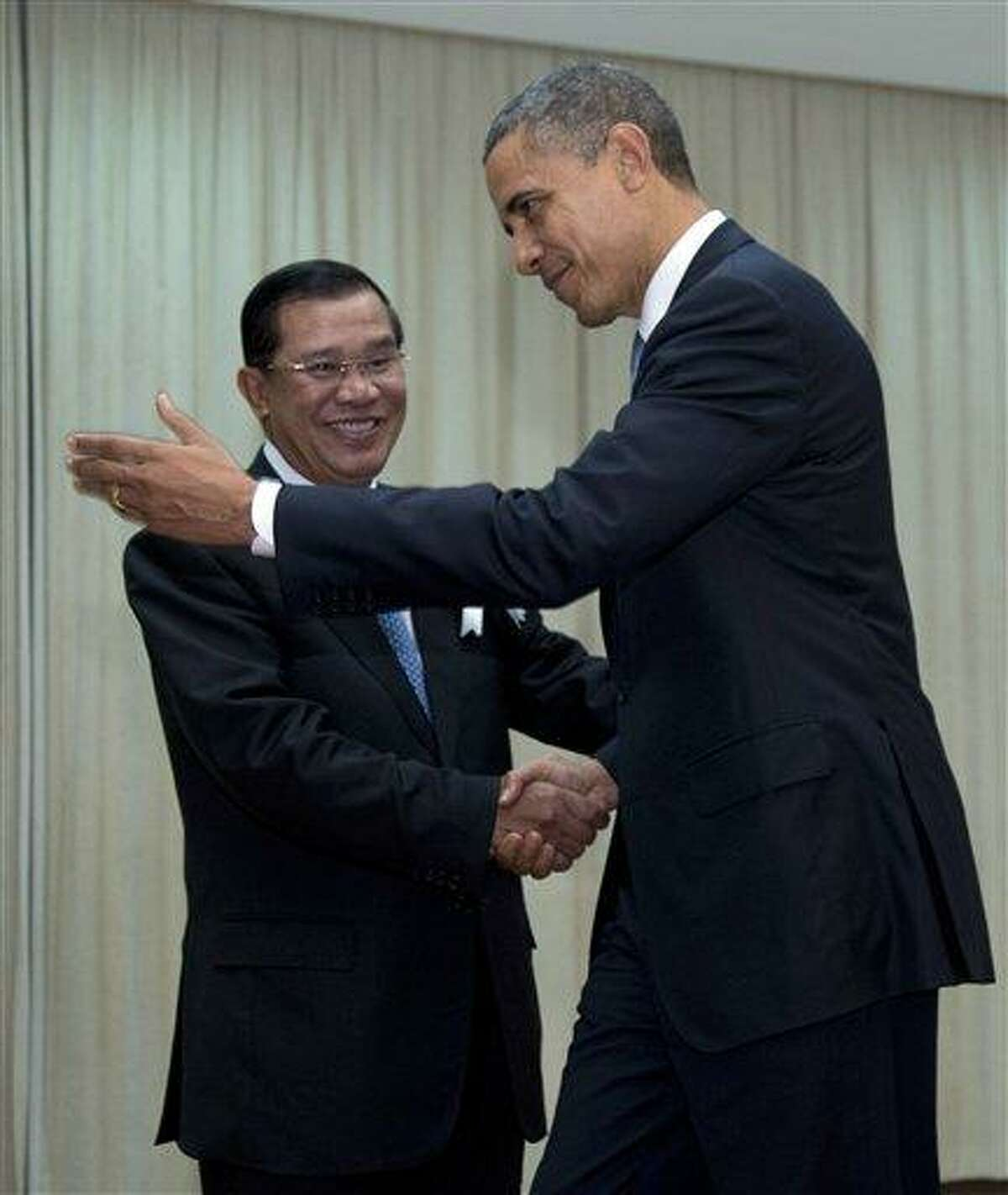 U.S. President Barack Obama is welcomed by Cambodia's Prime Minister Hun Sen as he arrives at the Peace Palace in Phnom Penh, Cambodia Monday. Obama will attend the East Asia Summit. AP Photo/Carolyn Kaster