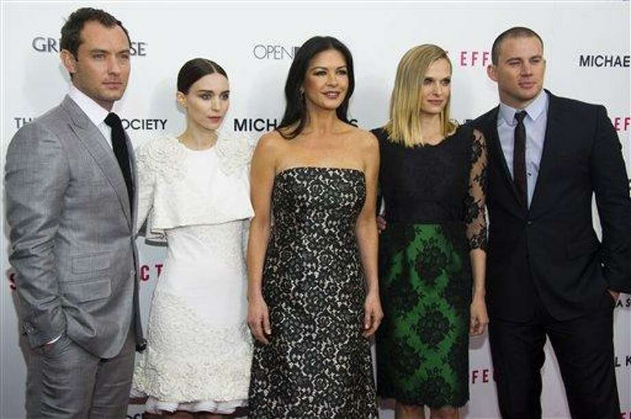 """Jude Law, from left, Rooney Mara, Catherine Zeta-Jones, Vinessa Shaw and Channing Tatum attend the premiere of """"Side Effects"""" hosted by the Cinema Society and Open Road Films on Thursday, Jan. 31, 2013 in New York. (Photo by Charles Sykes/Invision/AP) Photo: Charles Sykes/Invision/AP / Invision"""