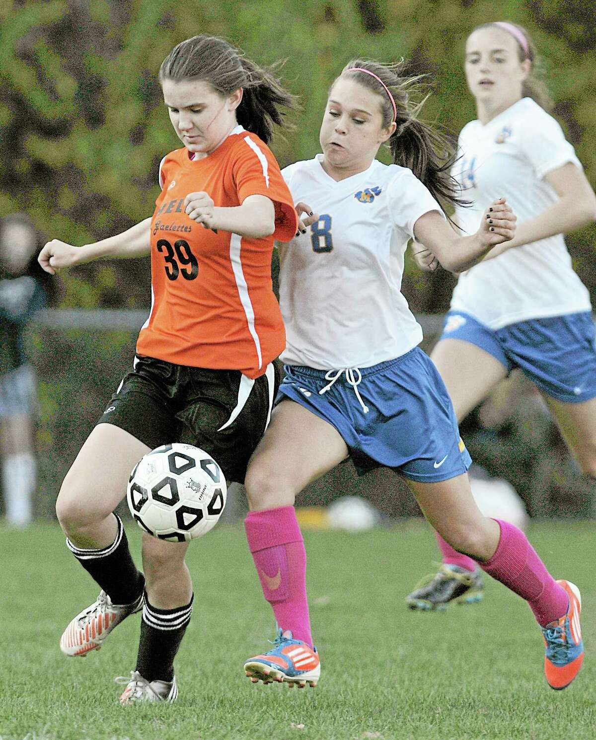 Mercy midfielder Emma Thomas and Shelton's Jillian Engeldrum compete for a loose ball near the Gaels goal Monday afternoon in Middletown. The Mercy Tigers won 6-1.