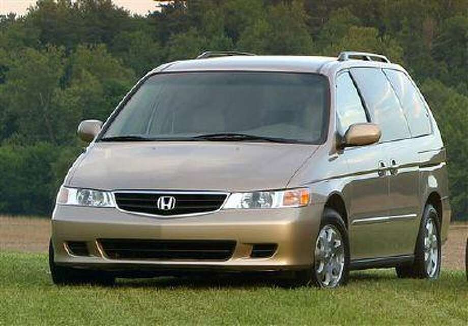 FILE - A 2003 Honda Odyssey is shown in an undated Honda Motor Company file photo. U.S. safety regulators have added about 320,000 older model Honda Odyssey minivans to a widening probe of faulty air bags that affects at least three automakers and more than 2 million vehicles. Front air bags on the Honda Motor Co. minivans from the 2003 and 2004 model years can inflate without a crash, possibly injuring drivers and passengers. (AP Photo/Honda Motor Company, File) Photo: AP / Honda Motor Company