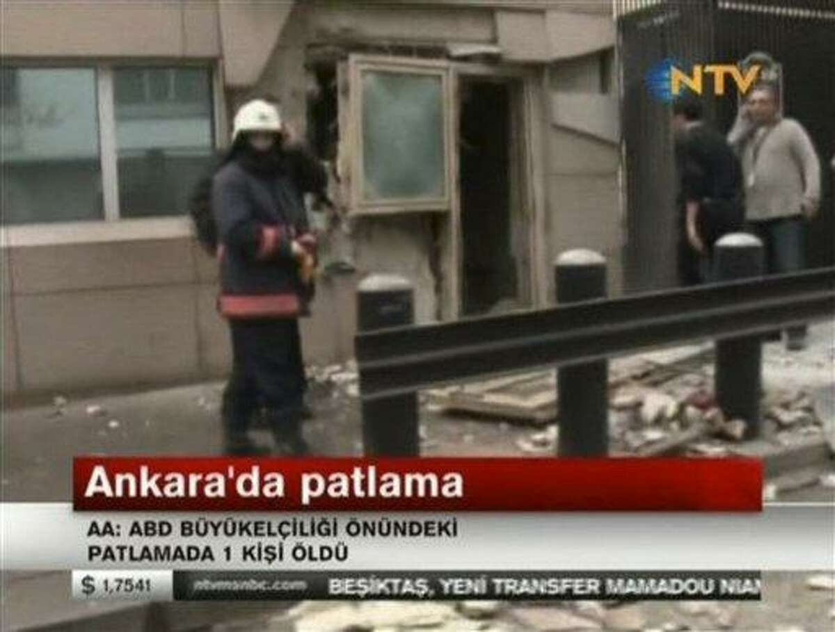 In this image made from video, emergency personnel are seen Friday in front of a side entrance to the U.S. Embassy following a blast in Ankara, Turkey. Associated Press