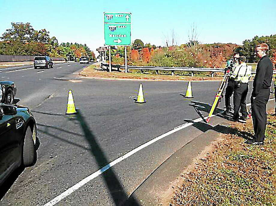 Police returned to the scene of Sunday night's fatal accident on Route 10 at the intersection of 691 in Cheshire to take additional measurements. Luther Turmelle/Register Photo: Journal Register Co.