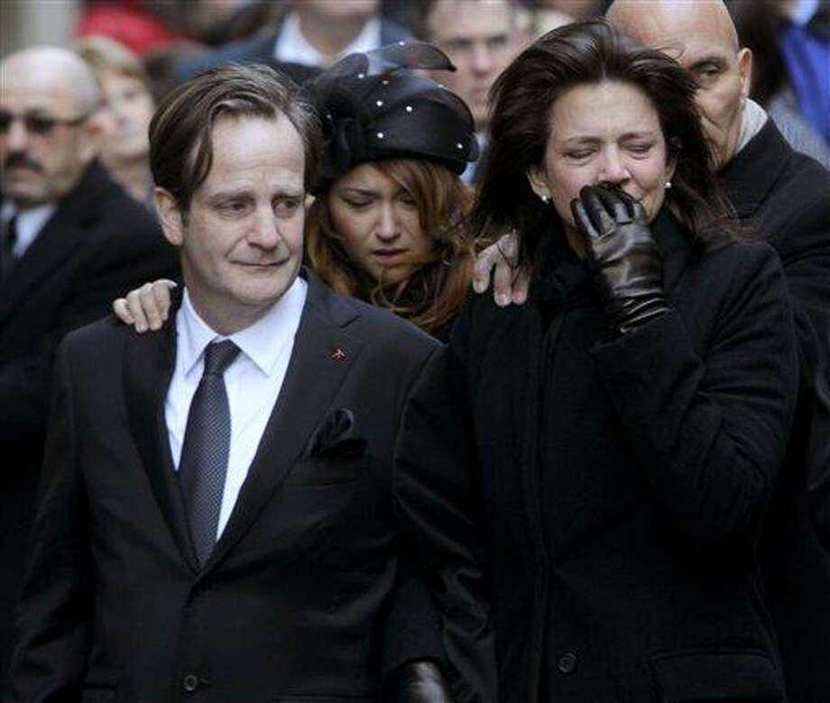 Matthew Badger, left, and Madonna Badger, the parents of three children that were killed in a fire, watch as their children's caskets are carried into a church during the funeral Jan. 5 in New York. Associated Press Photo: AP / AP2012