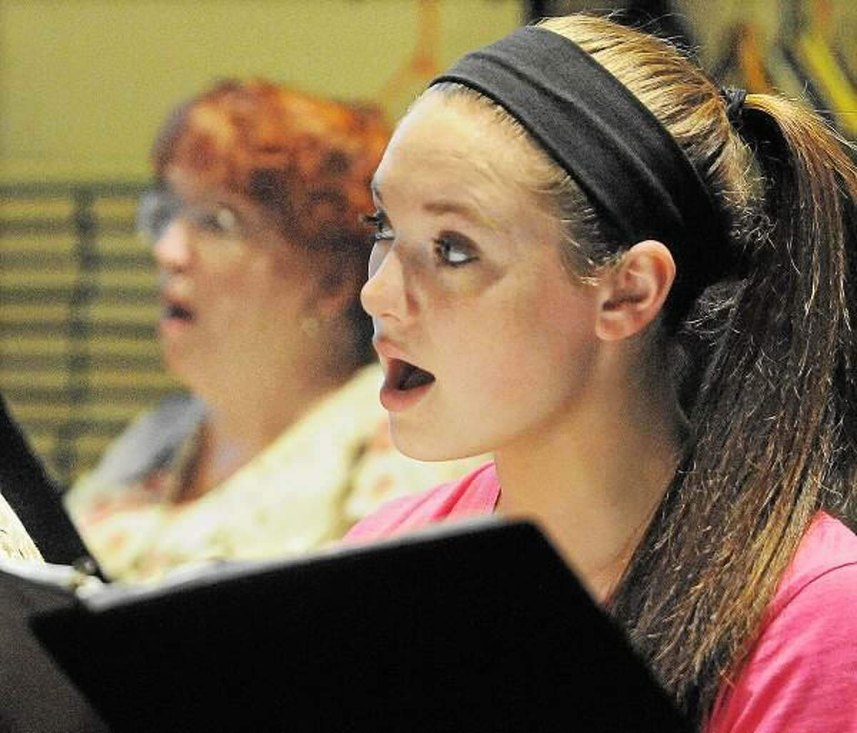 Catherine Avalone/The Middletown Press Altos Alison Luther, 17, of St. Colman Church and Judy Newton with the Church of the Holy Family in Hebron sing