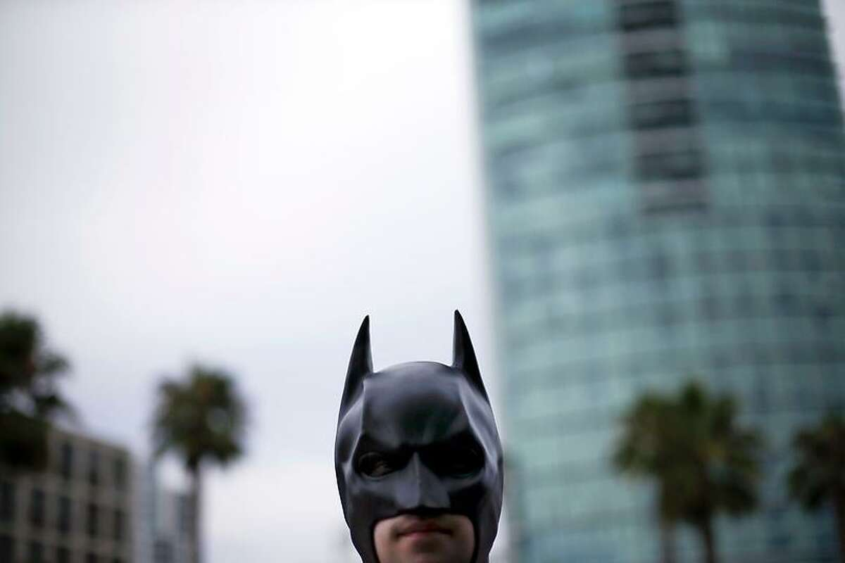 Jordan Kruegar dresses as Batman as he arrives to Comic-Con Wednesday, July 11, 2012, in San Diego. The annual comic book and popular arts convention attracts over 100,000 people and runs through July 15. (AP Photo/Gregory Bull)