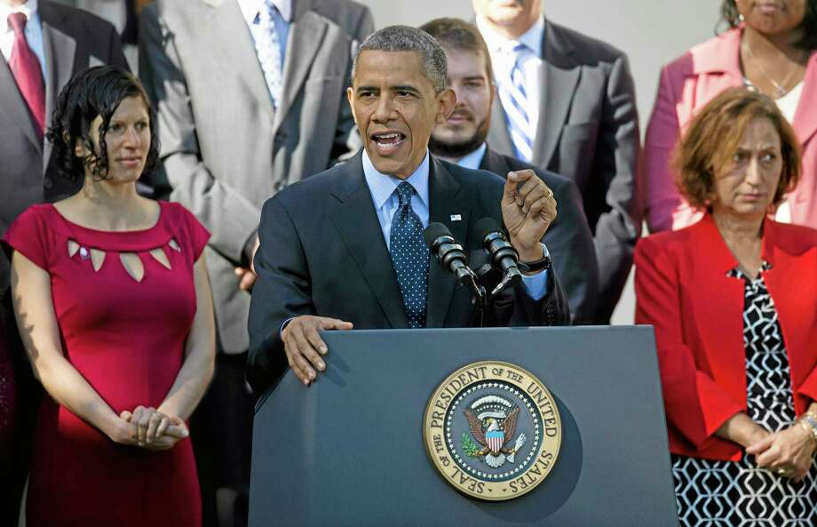 President Barack Obama gestures while speaking in the Rose Garden of the White House in Washington, Monday, Oct. 21, 2013, on the initial rollout of the health care overhaul. Obama acknowledged that the widespread problems with his health care law's rollout are unacceptable, as the administration scrambles to fix the cascade of computer issues.  (AP Photo/ Evan Vucci) Photo: AP / AP