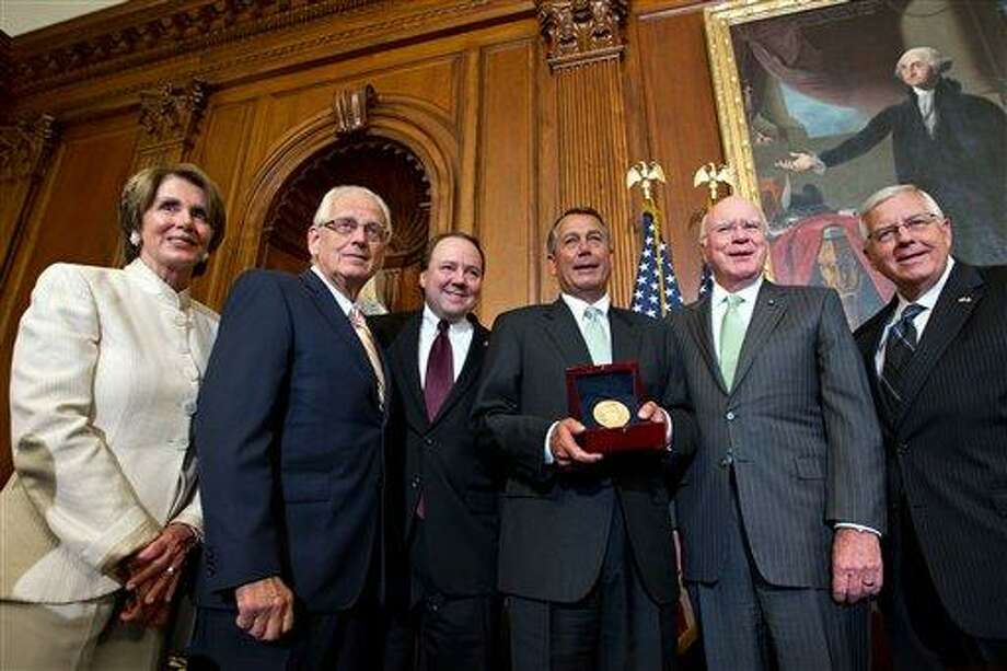 Lawmakers of both parties gather Wednesday to honor artist Constantino Brumidi posthumously with the Congressional Gold Medal for his artistic contributions to the U.S. Capitol building. From left are, House Minority Leader Nancy Pelosi of Calif.; Rep. Bill Pascrell Jr., D-N.J.; Rep. Pat Tiberi, R-Ohio; House Speaker John Boehner of Ohio; Sen. Patrick Leahy, D-Vt.; and Sen. Mike Enzi, R-Wyo.  Associated Press Photo: AP / AP