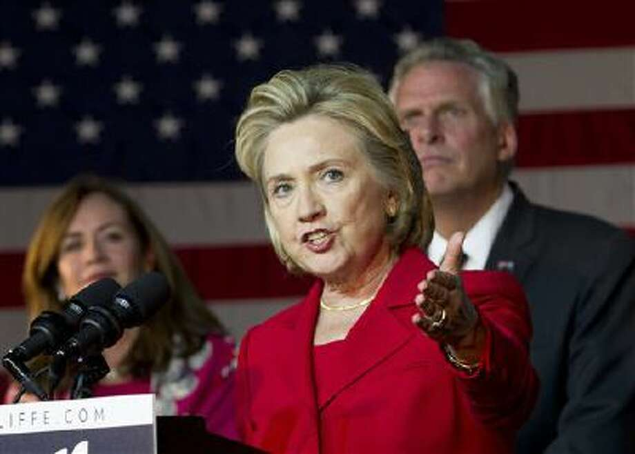 Former Secretary of State Hillary Clinton speaks at a campaign rally for Virginia gubernatorial candidate, Democrat Terry McAuliffe, right, on Oct. 19. Clinton is recognized as a leader for women's rights. (AP Photo/Jose Luis Magana) Photo: AP / FR159526 AP