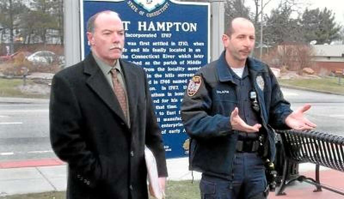 Jeff Mill/The Middletown Press East Hampton town counselor Ted Hintz, Jr. (left) listens as Police Union President Michael Salafia expresses the Union's dissatisfaction with Town Manager Michael Maniscalco during a press conference Friday morning at Town Hall. Both Hintz and Salafia were critical of Maniscalco's decision to name former Police Chief Matthew A. Reimondo as interim chief for the next three months while the town begins its search for a new chief.