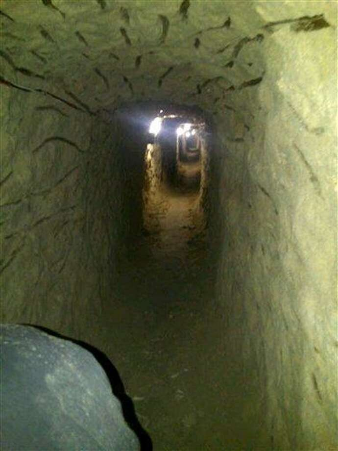 This image provided Thursday by the U.S. Immigration and Customs Enforcement shows a tunnel discovered by authorities designed to smuggle drugs into the United States, found in Tijuana, Mexico. An Immigration and Customs Enforcement spokeswoman said Thursday that the approximately 220-yard passage was lit and ventilated. It began under a bathroom sink inside a warehouse and did not cross the border into San Diego. Associated Press Photo: AP /  Immigration and Customs Enforcement