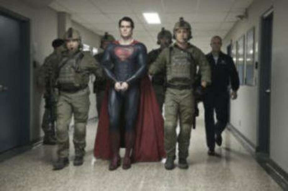 """This film publicity image released by Warner Bros. Pictures shows Henry Cavill as Superman in """"Man of Steel."""" (AP Photo/Warner Bros. Pictures, Clay Enos) Photo: AP / Warner Bros. Pictures net"""