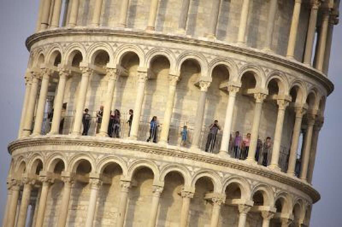 Tourists visit the leaning tower of Pisa, free of scaffoldings for the first time after 20 years of stabilization and restoration works on April 26, 2011.