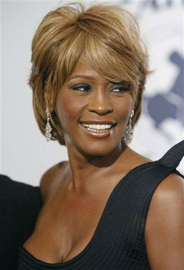 FILE - In this Oct. 28, 2006, file photo, musician Whitney Houston arrives at the 17th Carousel of Hope Ball benefiting the Barbara Davis Center for Childhood Diabetes in Beverly Hills, Calif. Coroner's officials said Thursday, March 22, 2012, that Houston drowned, but her death was also caused by heart disease and cocaine use that suggested she was chronically using the drug. Houston died Feb. 11, in California at the age of 48. (AP Photo/Matt Sayles) Photo: AP / AP2006