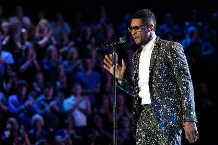 Usher during 'The Voice' on Monday, June 10, 2013. (Trae Patton/NBC) Photo: Trae Patton/NBC / 2013 NBCUniversal Media, LLC