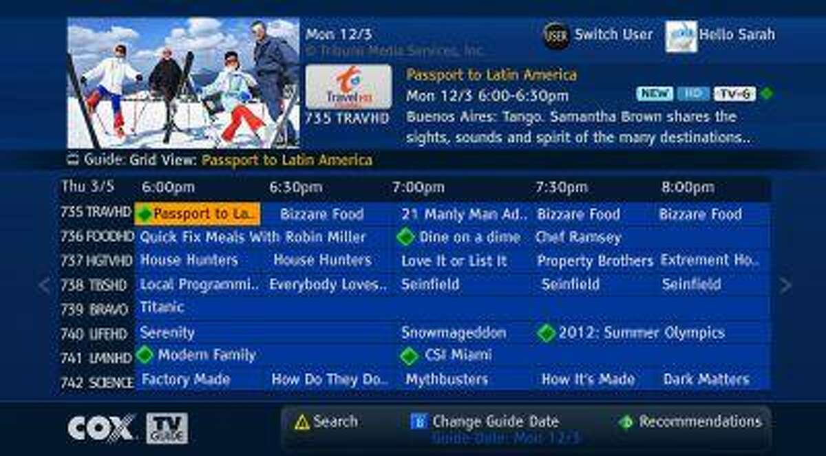 This image provided by Cox Communications shows a program guide for television set-top boxes to make it easier to find programs available live or on demand. It ís an important development for cable TV companies, as they face criticisms for providing hundreds of channels that customers don't watch. Making shows easier to find 'helps the companies justify all those channels.'