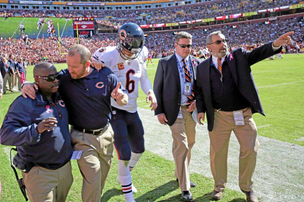 Chicago Bears quarterback Jay Cutler walks off the field after being injured on a sack from Washington Redskins defensive end Chris Baker during the first half of Sunday's game in Landover, Md.