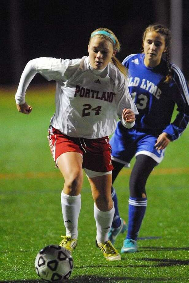 Catherine Avalone/The Middletown Press Portland's McKenzie Reimondo looks upfield against Old Lyme in the Shoreline title game earlier this season.