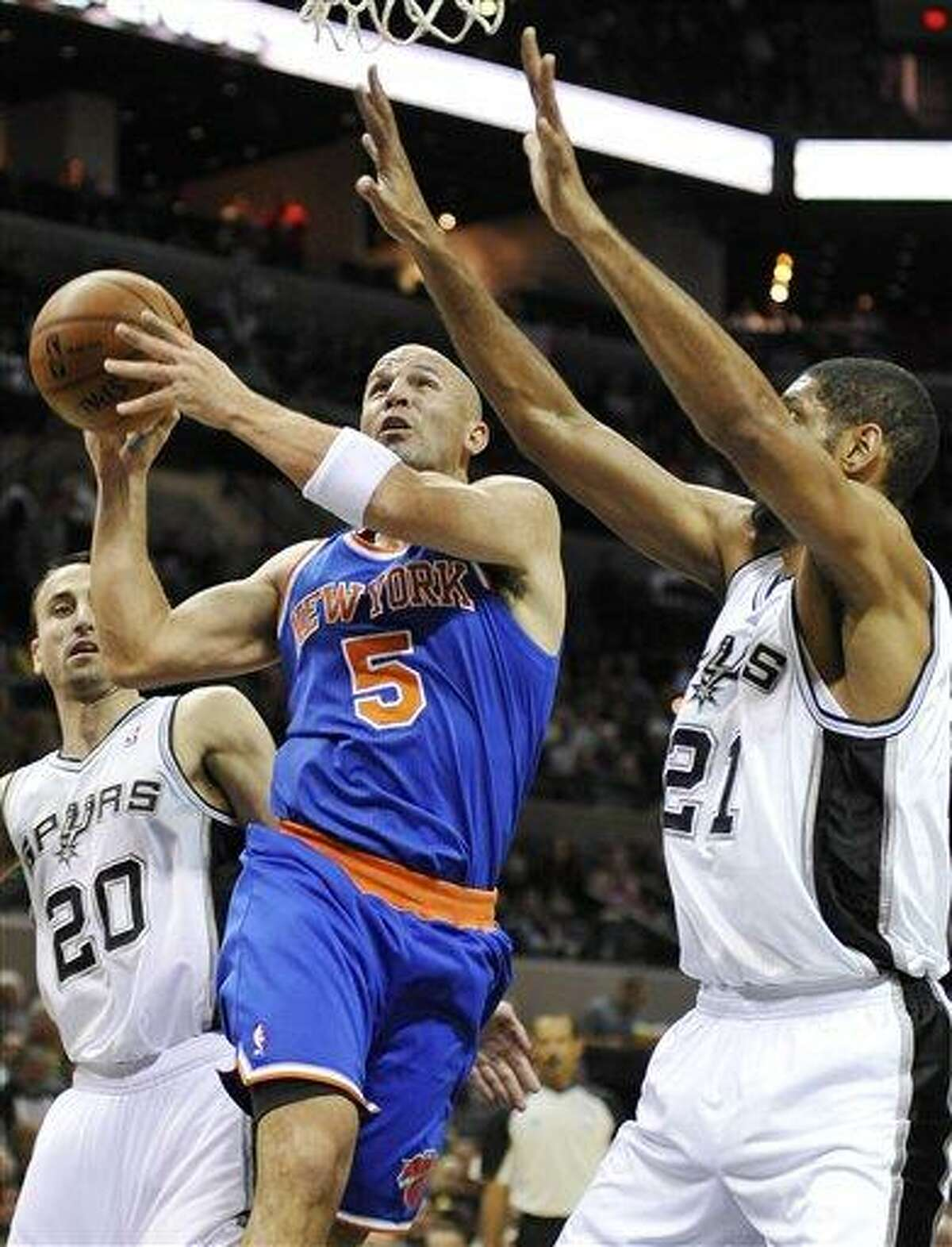 New York Knicks' Jason Kidd (5) shoots over San Antonio Spurs' Tim Duncan, right, during the first half of an NBA basketball game on Thursday, Nov. 15, 2012, in San Antonio. (AP Photo/Darren Abate)
