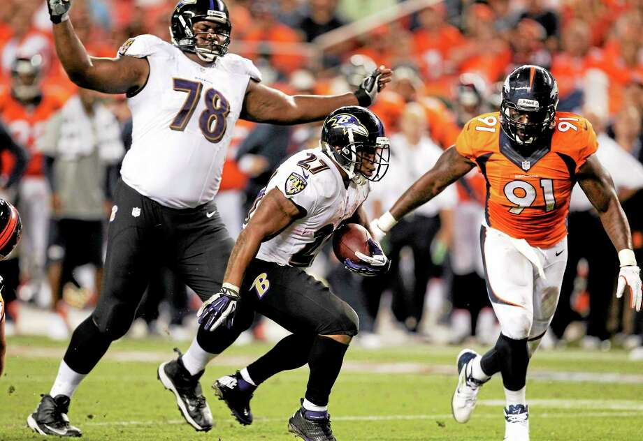 Baltimore Ravens running back Ray Rice (27) can't get into the end zone as teammate Bryant McKinnie (78) watches and Denver Broncos defensive end Robert Ayers pursues during their Sept. 5 game in Denver. Photo: Joe Mahoney — The Associated Press  / AP2013