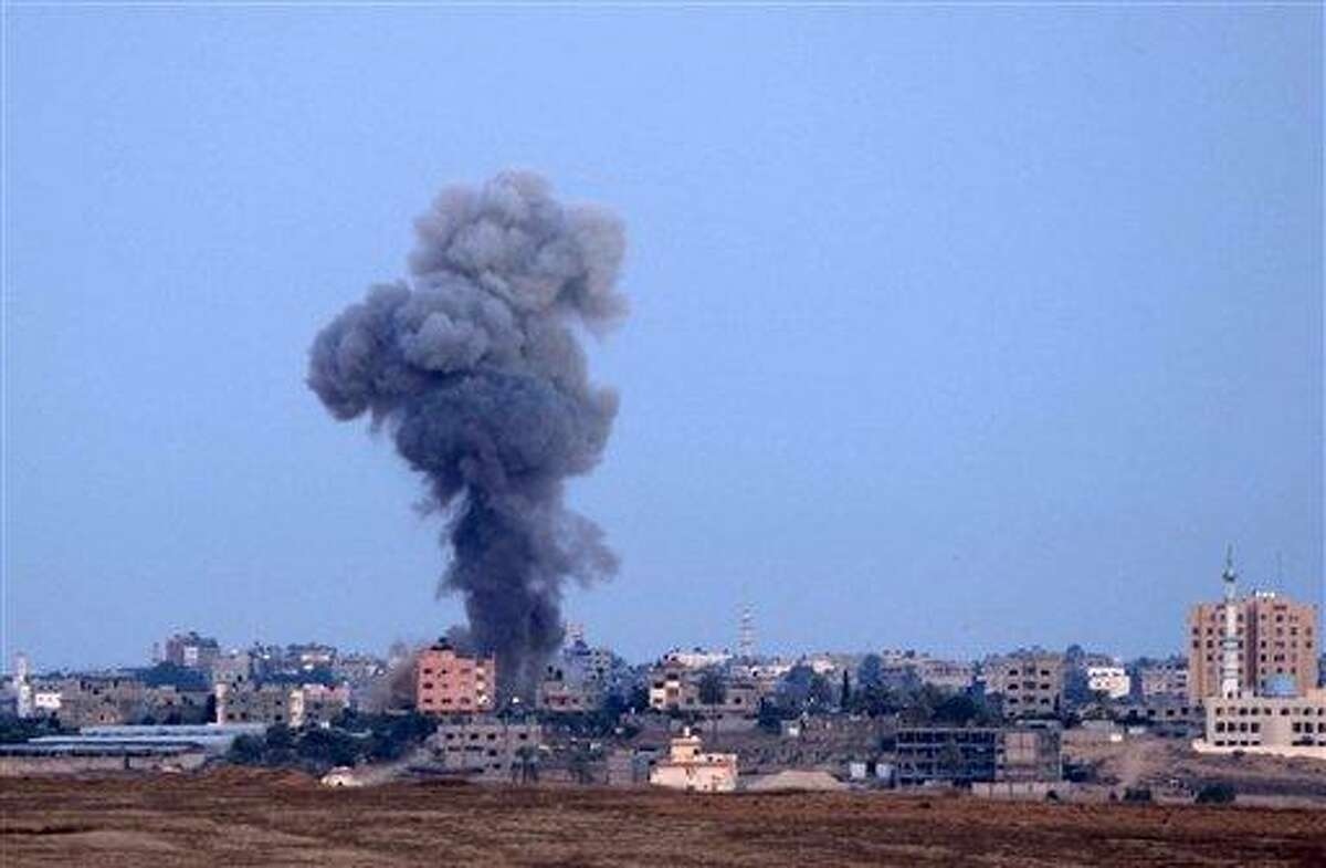 Smoke is seen after an Israeli strike in the northern Gaza Strip, Friday, Nov. 16, 2012. Early Friday, 85 missiles exploded within 45 minutes in Gaza City, sending black pillars of smoke towering above the coastal strip's largest city. The military said it was targeting underground rocket-launching sites. The Israeli offensive has not deterred the militants from firing more than 400 rockets aimed at southern Israel since Wednesday, the military said.(AP Photo/Sebastian Scheiner)