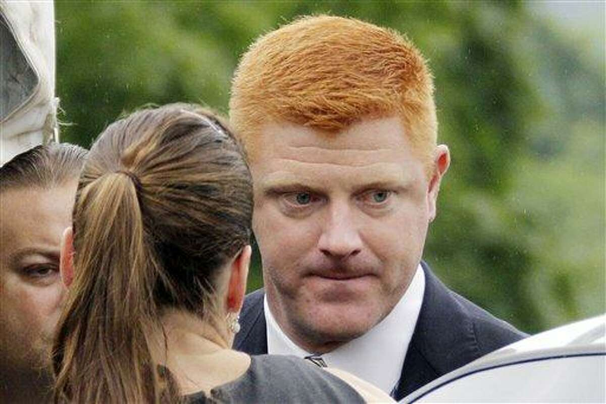 FILE - In this June 12, 2012 file photo, Penn State University assistant football coach Mike McQueary arrives at the Centre County Courthouse to testify in the child sexual abuse trial of former Penn State University assistant football coach Jerry Sandusky in Bellefonte, Pa. Lawyers for Penn State and McQueary are heading to court Friday, Nov. 16, 2012, over the university's request to put his whistleblower and defamation lawsuit on hold. (AP Photo/Gene J. Puskar, File)