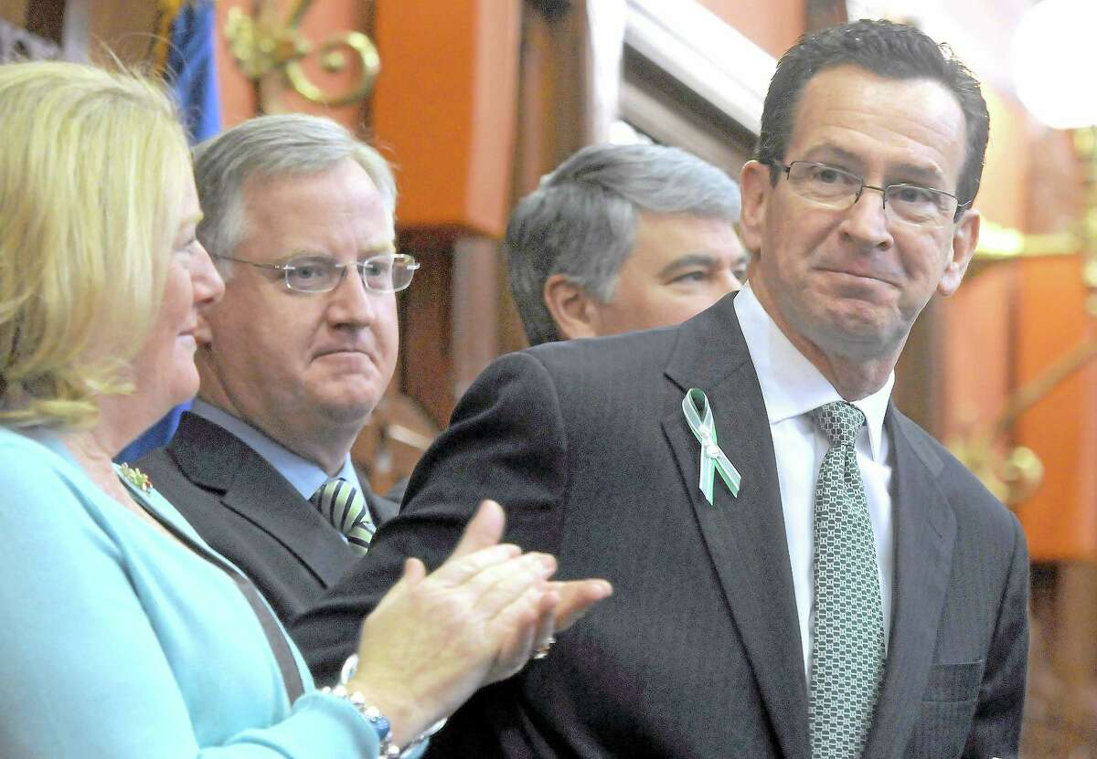 Gov. Dannel P. Malloy after his biennial budget address to the CT state legislature in February. His wife Cathy is at left, then House Speaker Brendan Sharkey, D-88, Senate President Pro Tempore Donald Williams, Jr. D-29.