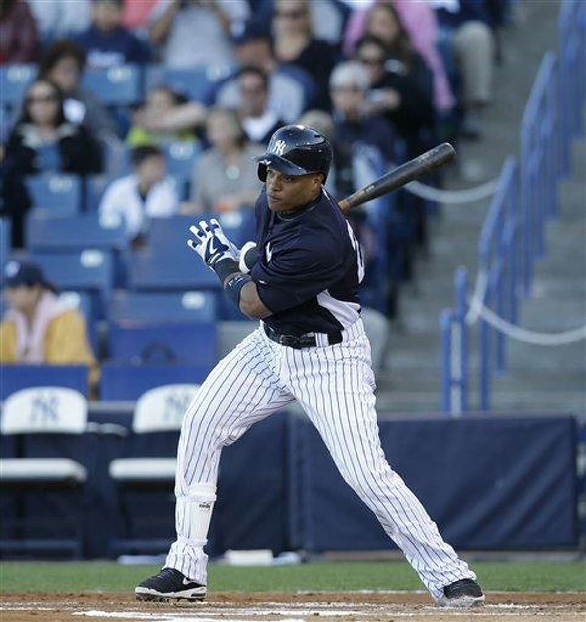 New York Yankees Robinson Cano bats in a spring training baseball game in Tampa, Fla., Thursday, March 21, 2013. (AP Photo/Kathy Willens)
