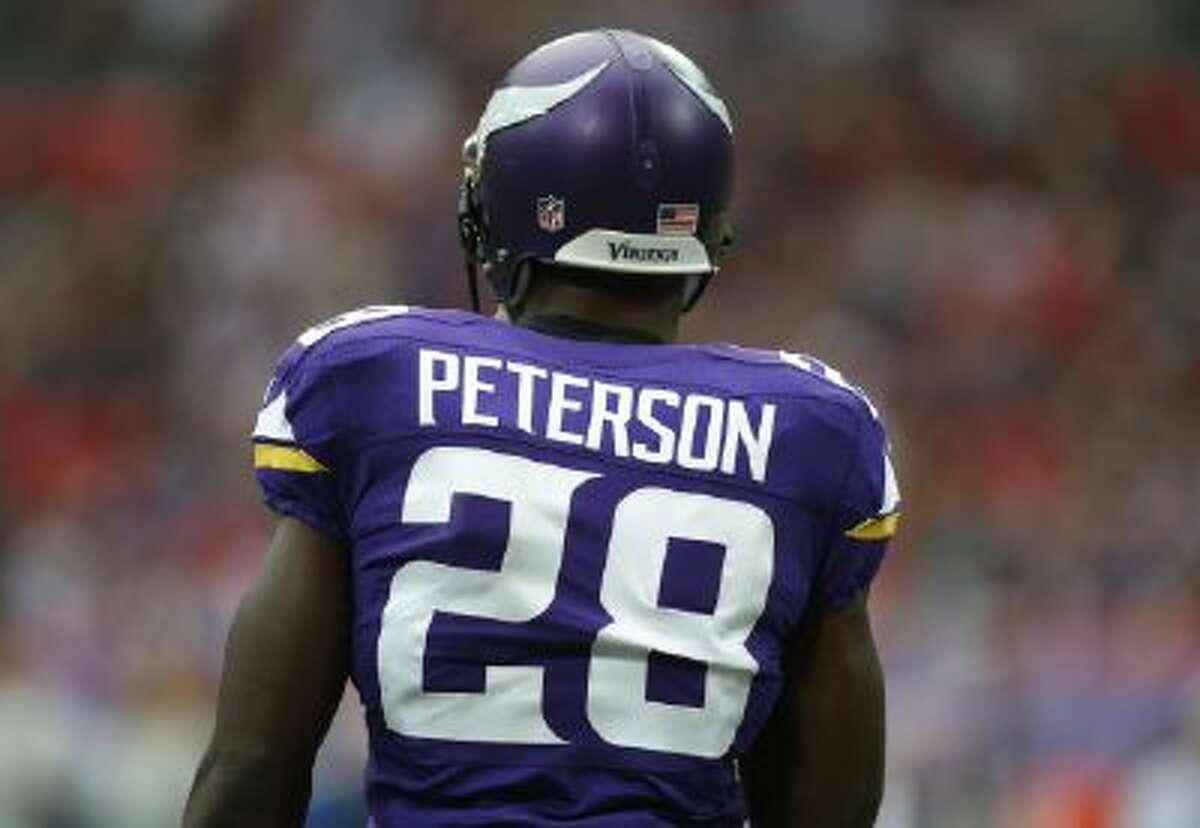 Minnesota Vikings running back Adrian Peterson warms up before their NFL football game against the Pittsburgh Steelers at Wembley Stadium, London, Sunday, Sept. 29, 2013.
