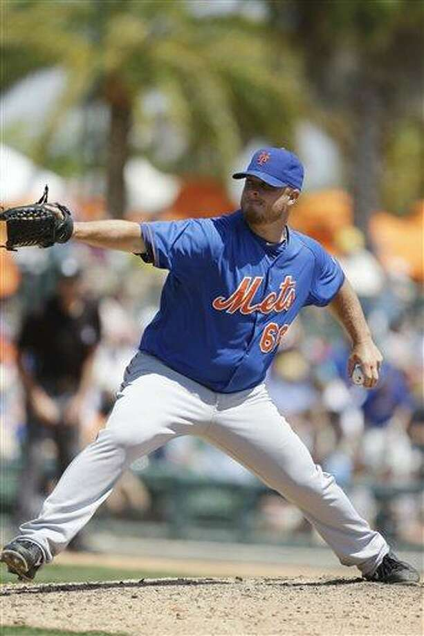 New York Mets relief pitcher Josh Edgin prepares to throw during the seventh inning of an exhibition spring training baseball game against the against the Baltimore Orioles, Saturday, March 30, 2013, in Sarasota, Fla. (AP Photo/Carlos Osorio) Photo: ASSOCIATED PRESS / AP2013
