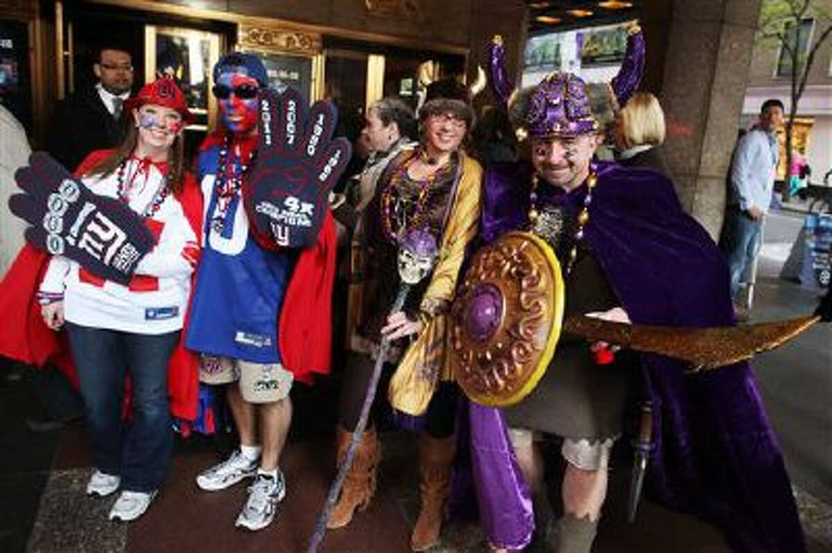 New York Giants and Minnesota Vikings fans arrive for the the second round of the NFL football draft at Radio City Music Hall, Friday, April 27, 2012, in New York.