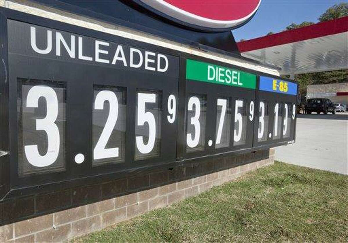 Lower fuel prices are advertised Oct. 30 at North Little Rock, Ark., gas station. Associated Press