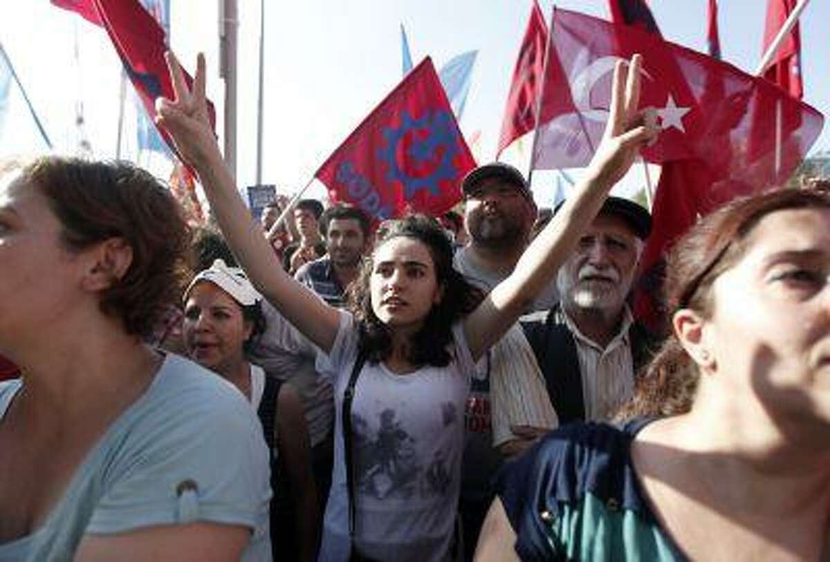 People shout anti-government slogans as they gather for a demonstration at Taksim Square in Istanbul June 9, 2013.