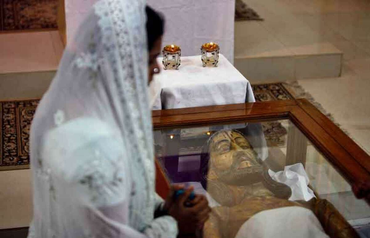 An Indian Christian prays at Our Lady of Lourdes Church on Good Friday in Hyderabad, India, Friday, March 29, 2013. Christians around the world are marking the Easter holy week. (AP Photo/Mahesh Kumar A.)