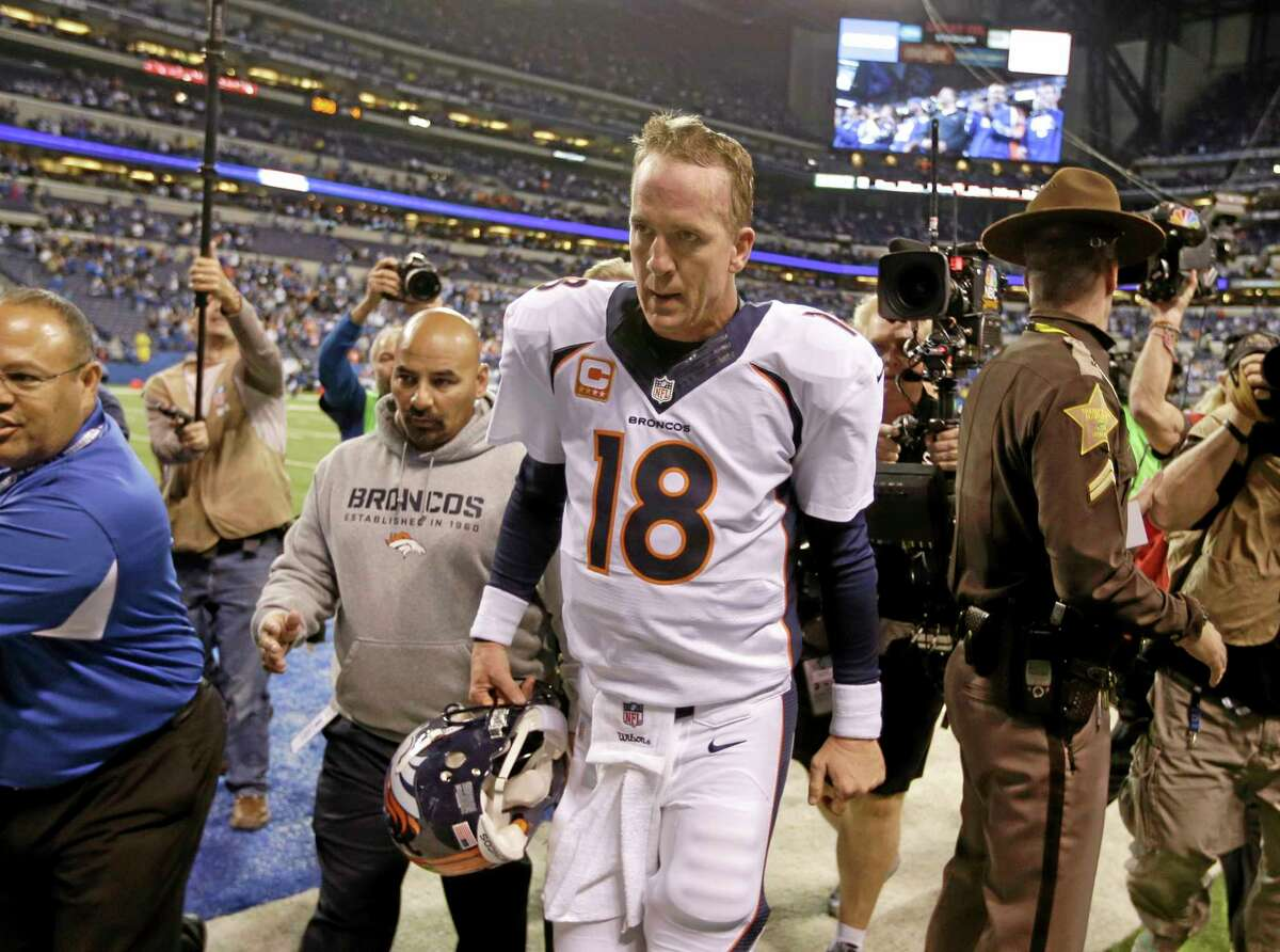 Denver Broncos quarterback Peyton Manning walks off the field after Sunday's game against the Colts in Indianapolis. The Colts won 39-33.