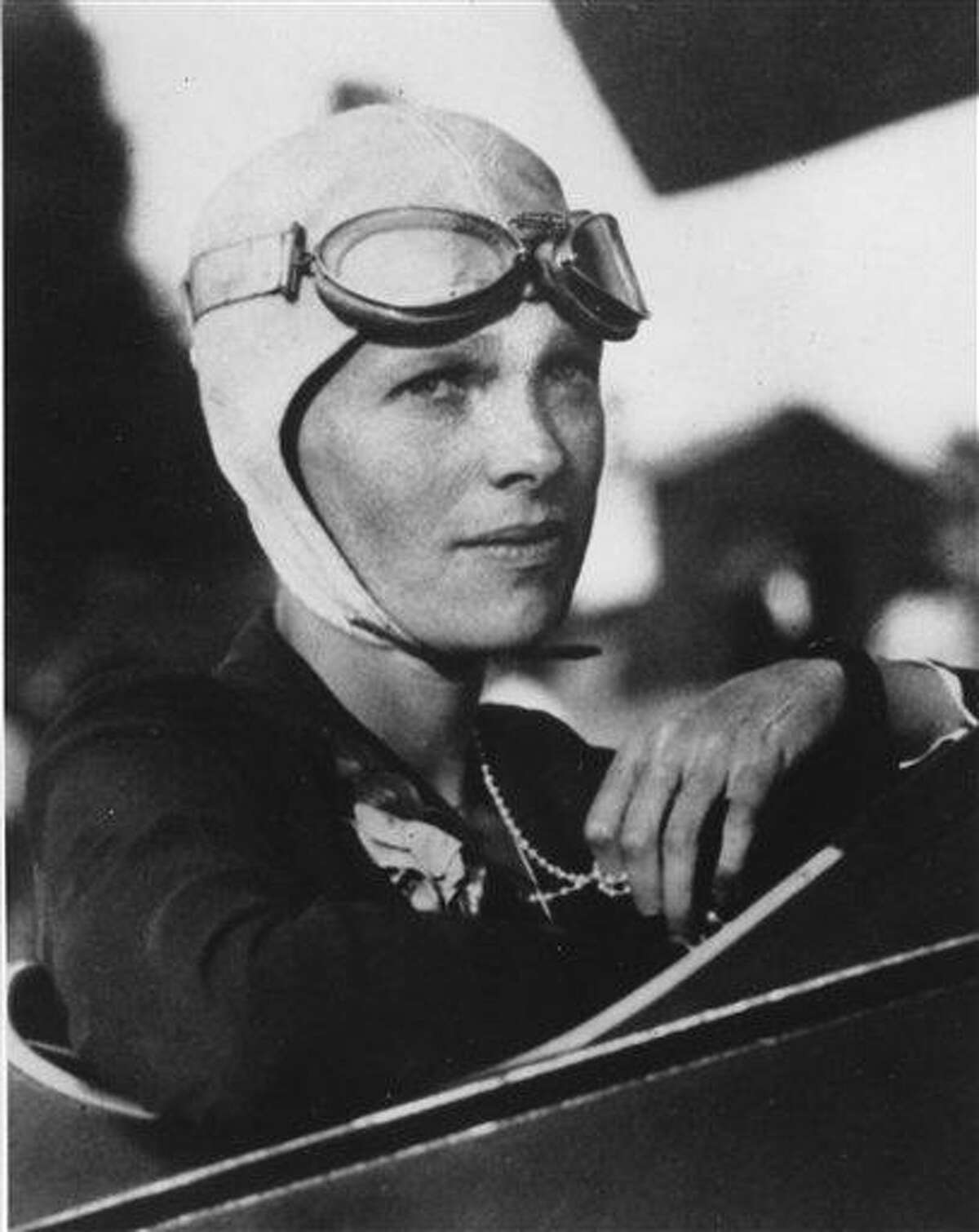 An undated file photo shows Amelia Earhart, the first woman to fly solo across the Atlantic Ocean. Secretary of State Hillary Rodham Clinton is meeting Tuesday with historians and scientists from The International Group for Historic Aircraft Recovery, which will launch a new search in June for the wreckage of Earhart's plane off the remote island of Nikumaroro. Associated Press