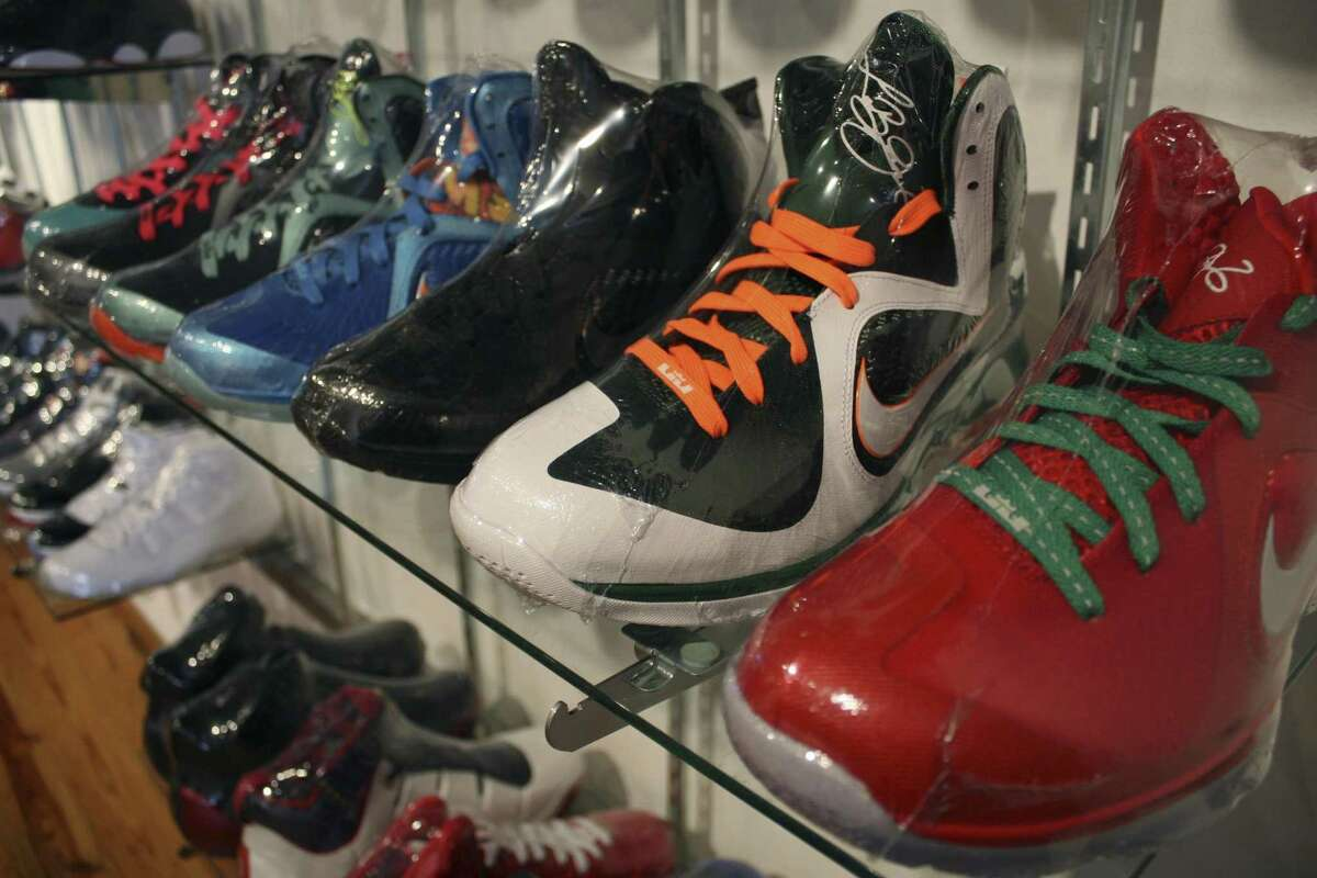 Limited edition sneakers, wrapped in plastic to protect them, sit in a Chicago consignment store. Associated Press file photo