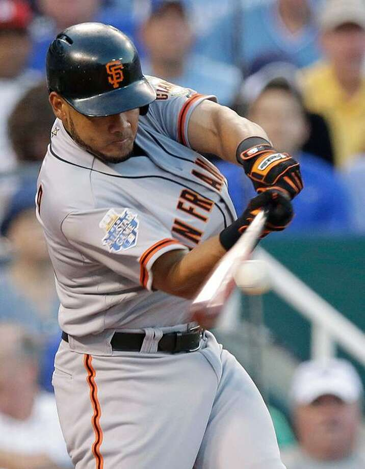 National League's Melky Cabrera, of the San Francisco Giants, hits a two-run home run during the fourth inning of the MLB All-Star baseball game Tuesday, July 10, 2012, in Kansas City, Mo. (AP Photo/Charlie Riedel) Photo: AP / AP2012