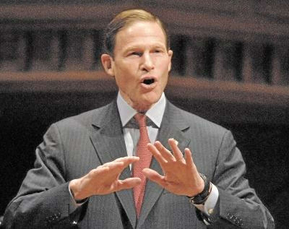 Catherine Avalone/The Middletown Press U.S Senator Richard Blumenthal-D speaks to Wesleyan students about banning assault weapons Friday evening at Wesleyan's Memorial Chapel.