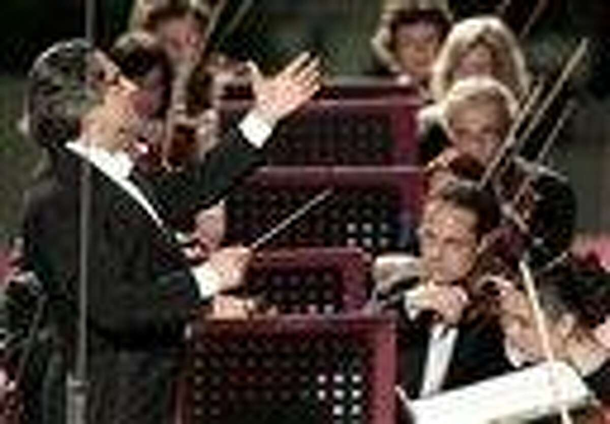 This May file photo shows Riccardo Muti conducting his orchestra during a concert to celebrate Pope Benedict XVI's Pontificate at the Vatican. Muti, the master conductor, is sounding an ominous note, worried that the stubborn financial crisis in much of the world risks impoverishing not just public coffers but also the arts, whose budgets, often lean in good economic times, are among the biggest casualties in many countries. (AP Photo/Gregorio Borgia, files)