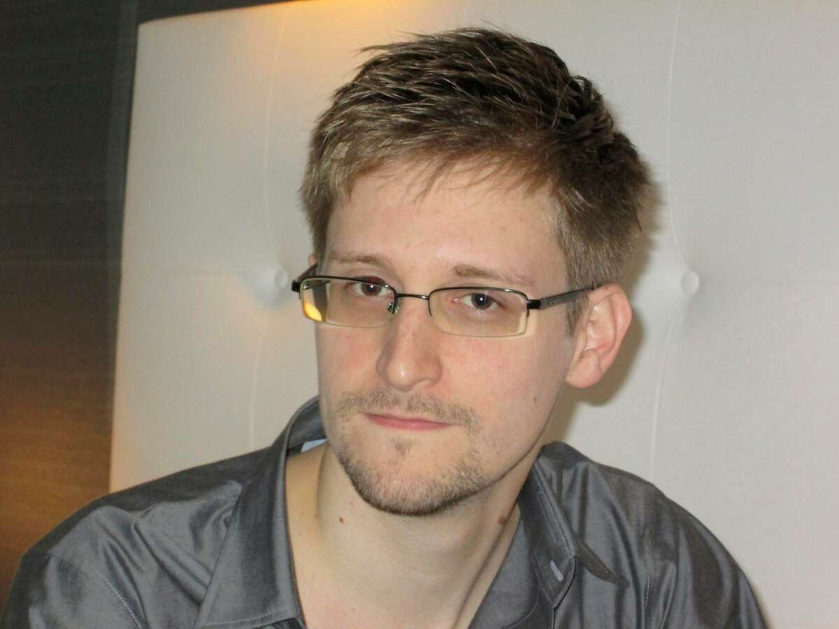 U.S. National Security Agency whistleblower Edward Snowden, an analyst with a U.S. defence contractor, is pictured during an interview with the Guardian in his hotel room in Hong Kong June 9, 2013. The 29-year-old contractor at the NSA revealed top secret U.S. surveillance programmes to alert the public of what is being done in their name, the Guardian newspaper reported on Sunday. Snowden, a former CIA technical assistant who was working at the super-secret NSA as an employee of defence contractor Booz Allen Hamilton, is ensconced in a hotel in Hong Kong after leaving the United States with secret documents. REUTERS/Ewen MacAskill/The Guardian/Handout (CHINA - Tags: POLITICS MEDIA) ATTENTION EDITORS - THIS IMAGE WAS PROVIDED BY A THIRD PARTY. FOR EDITORIAL USE ONLY. NOT FOR SALE FOR MARKETING OR ADVERTISING CAMPAIGNS. THIS PICTURE IS DISTRIBUTED EXACTLY AS RECEIVED BY REUTERS, AS A SERVICE TO CLIENTS. NO SALES. NO ARCHIVES. THIS PICTURE IS DISTRIBUTED EXACTLY AS RECEIVED BY REUTERS, AS A SERVICE TO CLIENTS. MANDATORY CREDIT