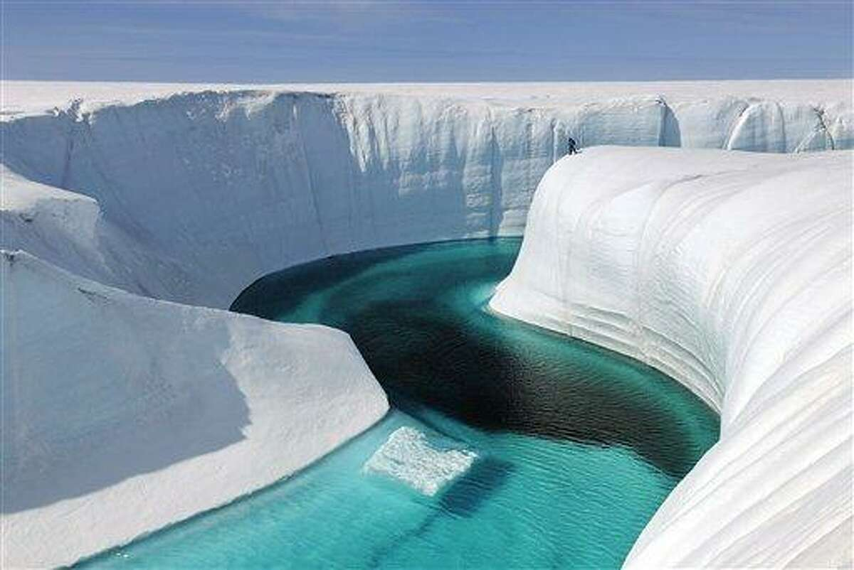 """This 2009 photo released by Extreme Ice Survey shows Birthday Canyon in Greenland furing the filming of """"Chasing Ice."""" The film, about climate change, follows National Geographic photographer James Balog across the Arctic as he deploys revolutionary time-lapse cameras designed to capture a multi-year record of the world's changing glaciers. (AP Photo/Extreme Ice Survey, James Balog)"""