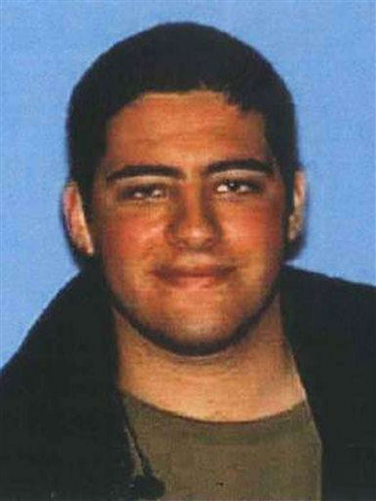 This undated photo provided on Sunday, June 9, 2013, by the Santa Monica Police Department shows John Zawahri, 23, who police have identified as the shooter in Friday's deadly rampage at Santa Monica College. The suspect was shot and killed by authorities Friday after a violent spree that claimed the lives of five people and wounded several others. (AP Photo/Santa Monica Police Department)
