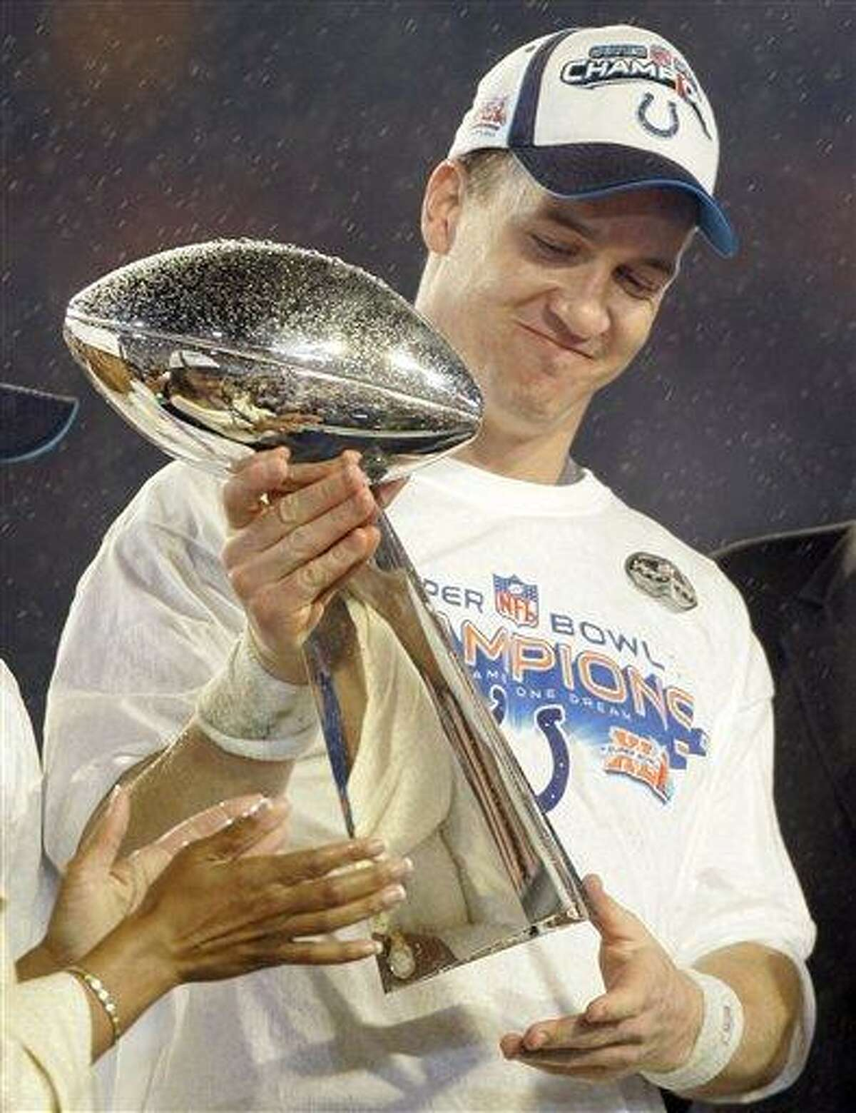 FILE - In this Feb. 4, 2007 file photo, Indianapolis Colts' Peyton Manning holds the Vince Lombardi Trophy after the Colts' 29-17 win over the Chicago Bears in the Super Bowl XLI football game at Dolphin Stadium in Miami. While fans from San Francisco to Denver to Tennessee can picture Peyton Manning hoisting the Lombardi Trophy in their team's jersey just as he did for Indianapolis five years ago, history offers a cautionary tale. No quarterback in NFL history has ever been the Super Bowl winner for two franchises. (AP Photo/Amy Sancetta, File)