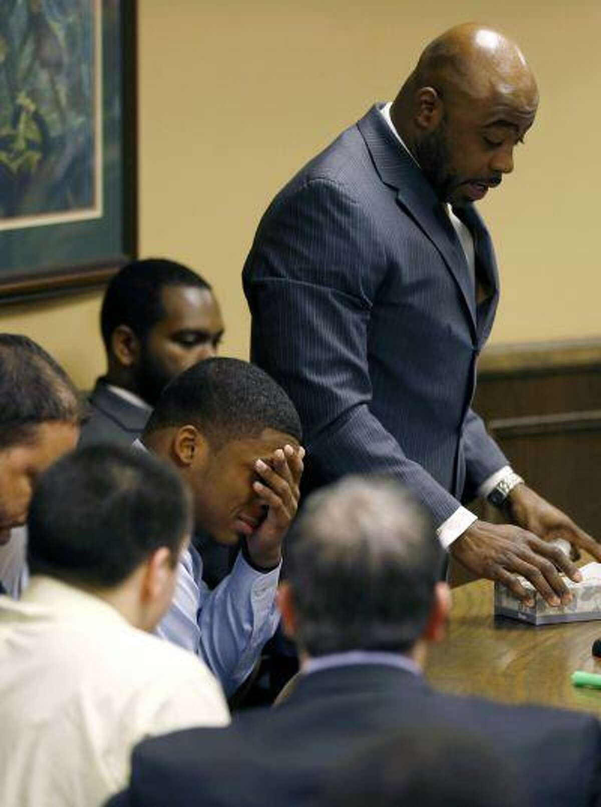Ma'Lik Richmond covers his eyes and cries as his attorney Walter Madison, standing, asks the court for leniency after Richmond and co-defendant Trent Mays, lower left, were found delinquent on rape and other charges after their trial in juvenile court in Steubenville, Ohio, March 17. Mays and Richmond were accused of raping a 16-year-old West Virginia girl in August 2012.