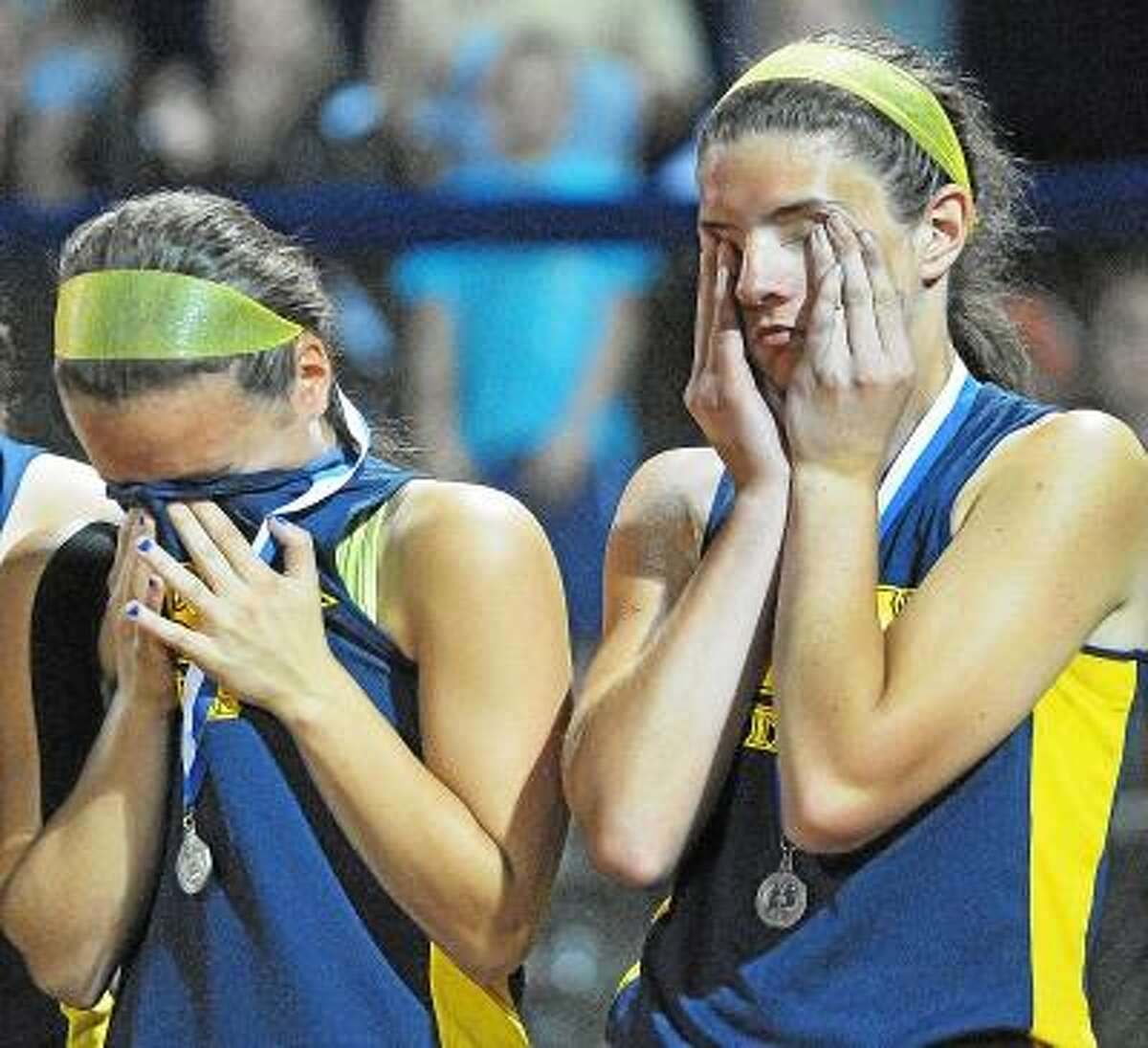 Catherine Avalone/The Middletown Press Mercy third baseman Stephanie Mangiameli and pitcher Mary Adametz upset following their 1-0 loss against Southington at Frank Biondi Softball Field at West Haven High School in the Class LL State Championship game Sunday night.