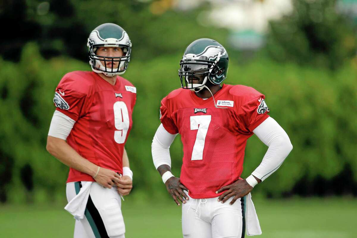 Philadelphia Eagles quarterback Nick Foles (9) will get the start this week with Michael Vick (7) still recovering from a hamstring injury.